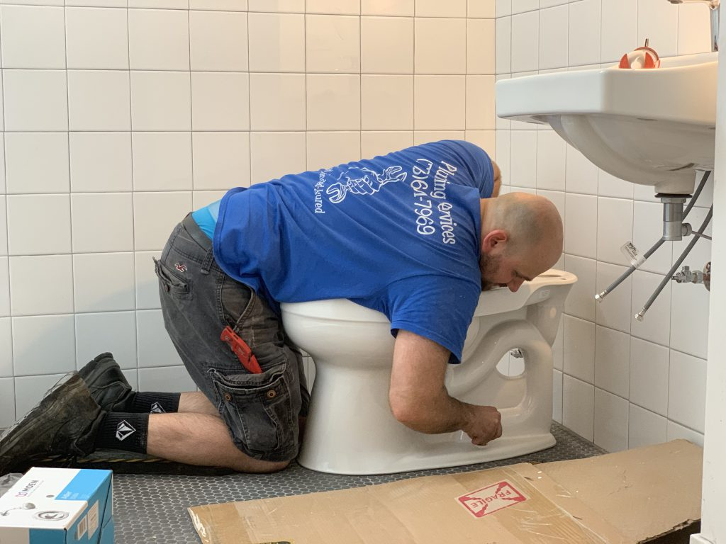 Toilet installation by First Chicago Plumbing.