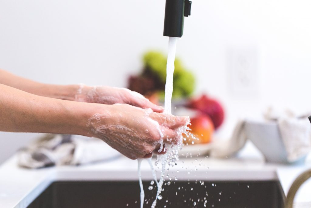 Washing hands using kitchen faucet